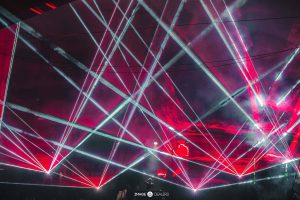 Red and White Lasers Shining throughout the room during Martin Garrix performance at Green Valley night club
