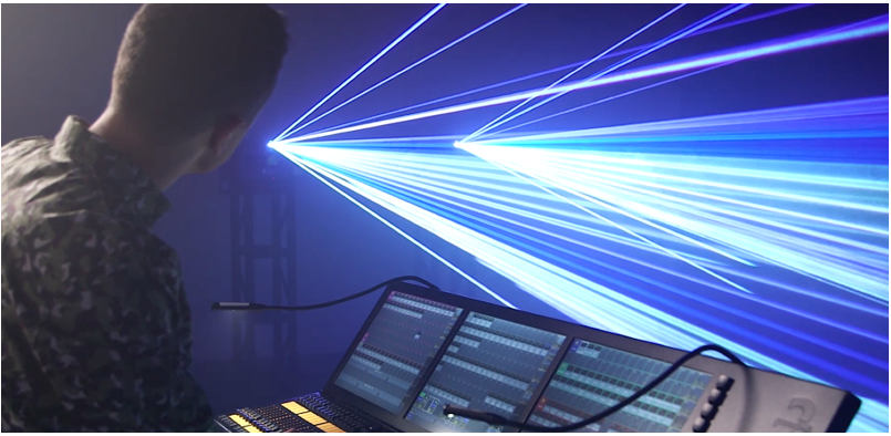 Lighting console with laser in action