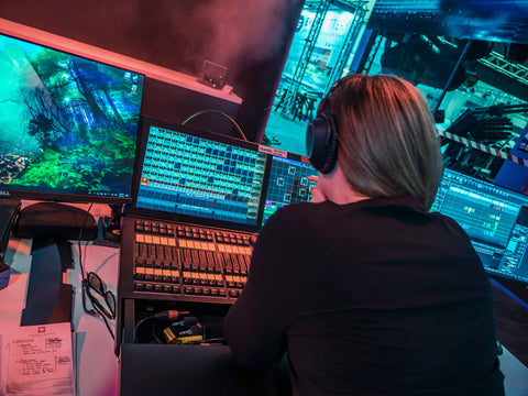 Lyra Letourneau, laser and lighting programmer, working from MA2 lighting console to program laser lights