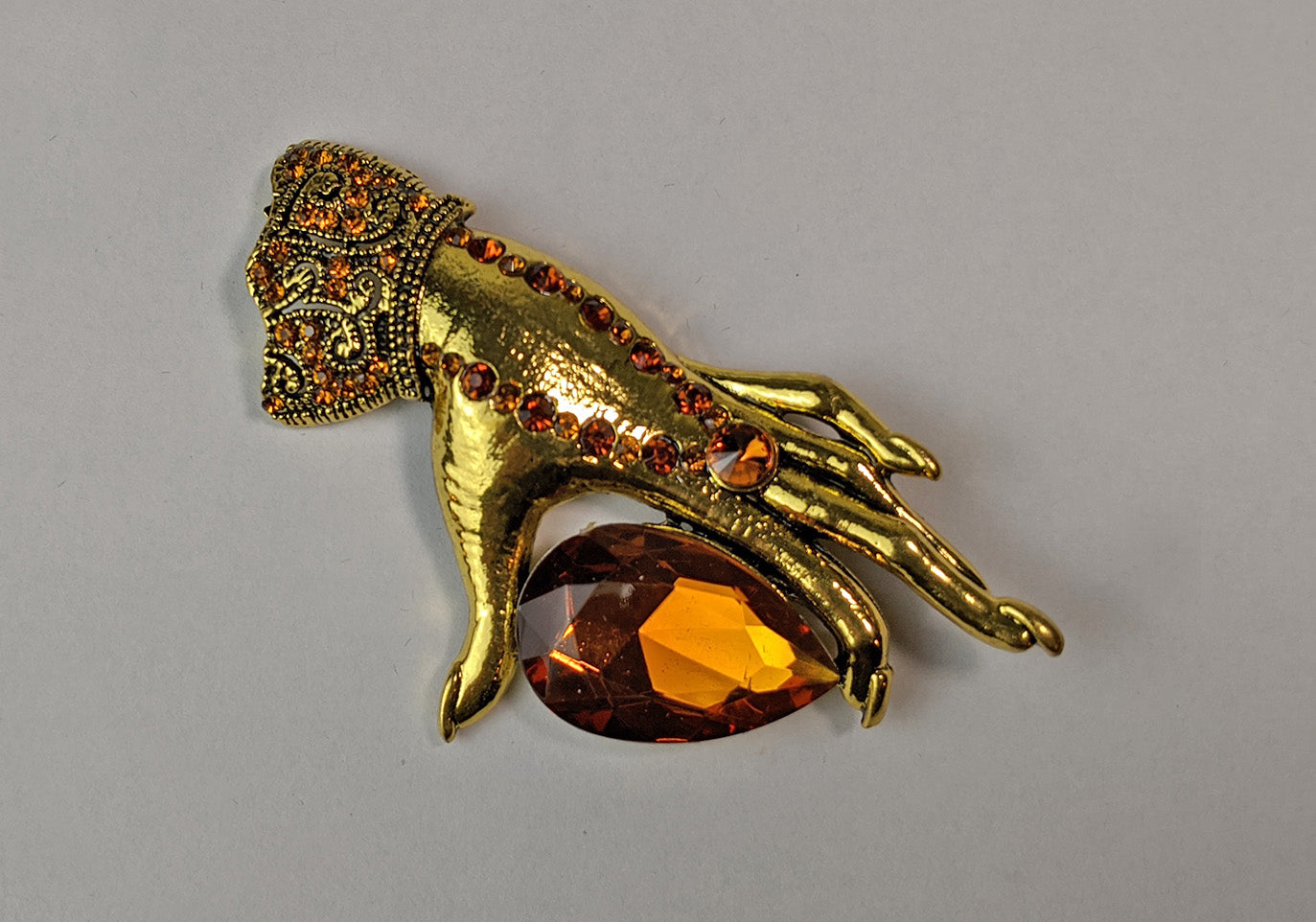"""Umbra"" <BR>Golden Hand and Rhinestone Brooch"
