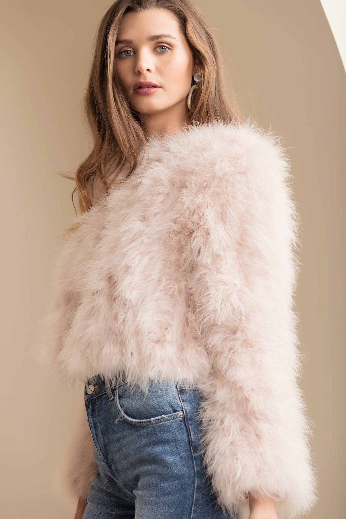 model wearing bubish luxe blush pink feather manhattan jacket