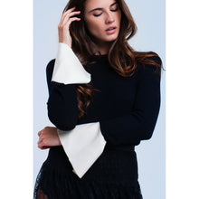 Black sweater with white cuffs
