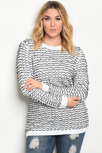 Plus size knit sweater top with a crew neckline.