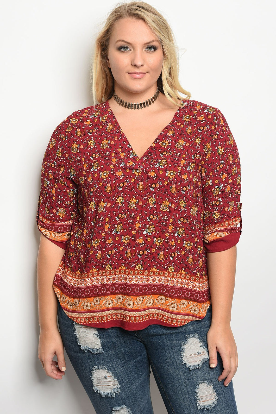 Plus size 3/4 sleeve multi print top with a v neckline