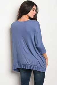 Ladies fashion 3/4 sleeve relaxed fit top with a v neckline