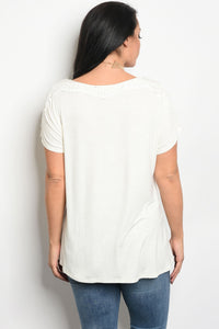 Ladies fashion plus size short sleeve top that features embroidery detail and a rounded neckline