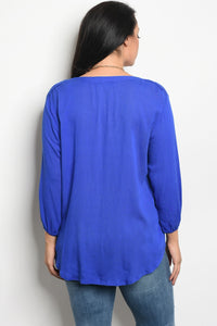 Ladies fashion plus size long sleeve top that features a v neckline with a tie detail and embroidered details