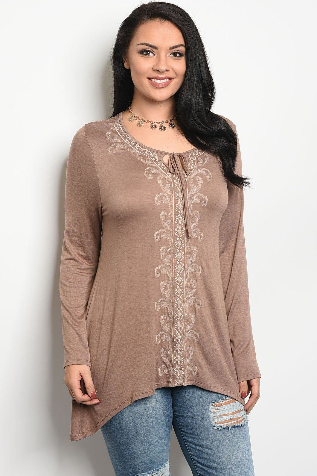 Ladies fashion plus size long sleeve light weight jersey top that features printed details and a scoop neckline