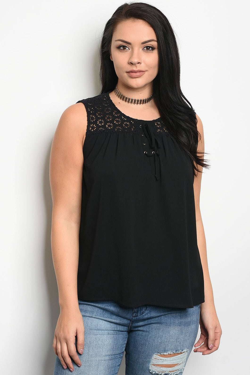 Plus size sleeveless top that features a scoop neckline and lace details