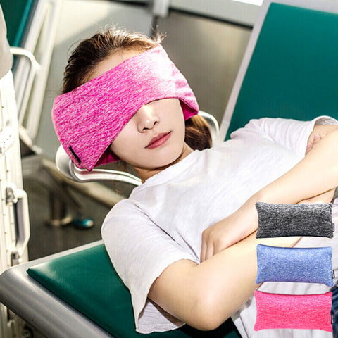 taking a nap at the airport with Travelsmart Neck Support Pillow & Eye Mask