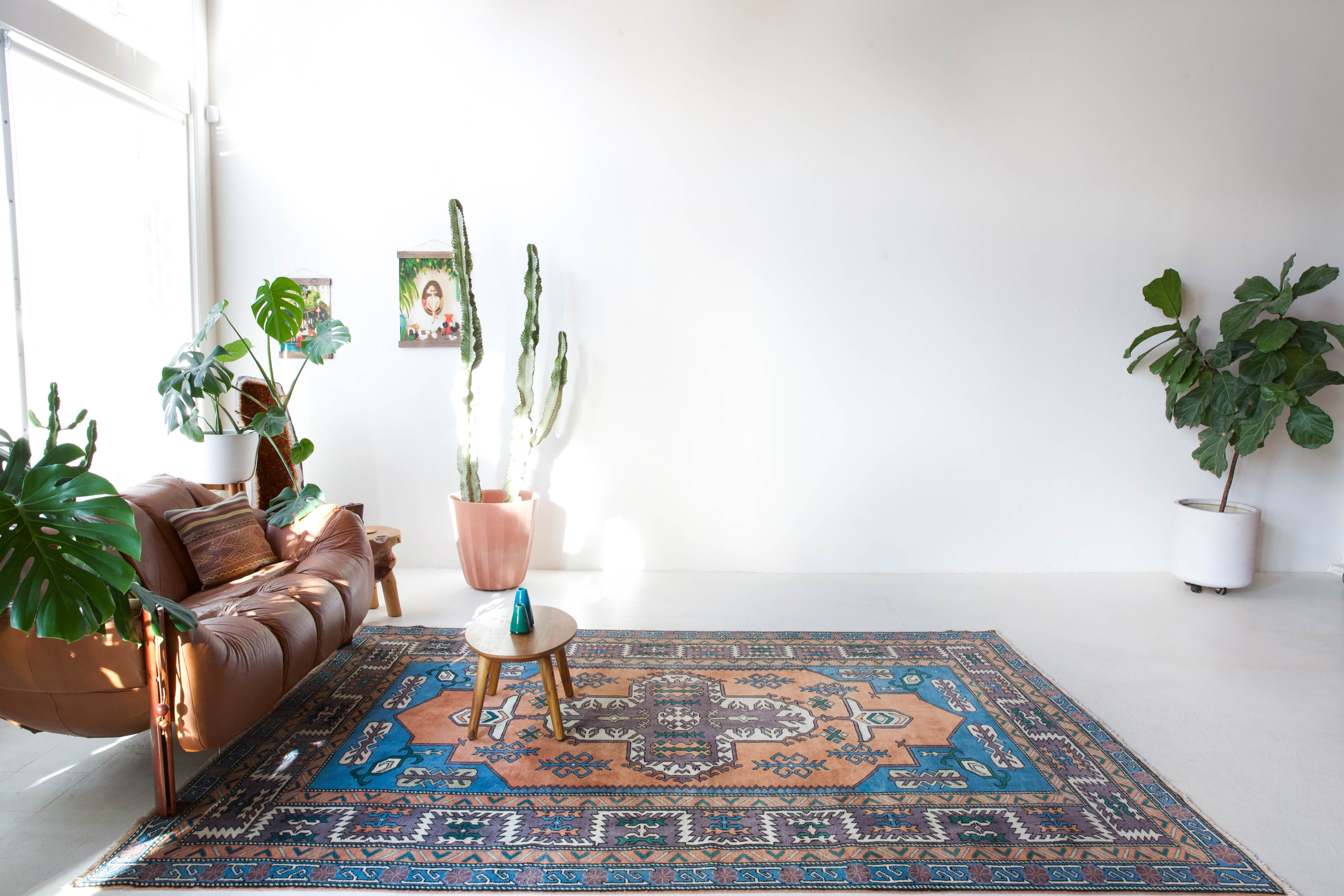 Vintage Turkish rug in living room setting, old rug, antique rug, pastel colors, faded colors, Turkish rug, vintage rug, soft rug, Portland, Oregon, rug store, rug shop, local shop, pastel colors