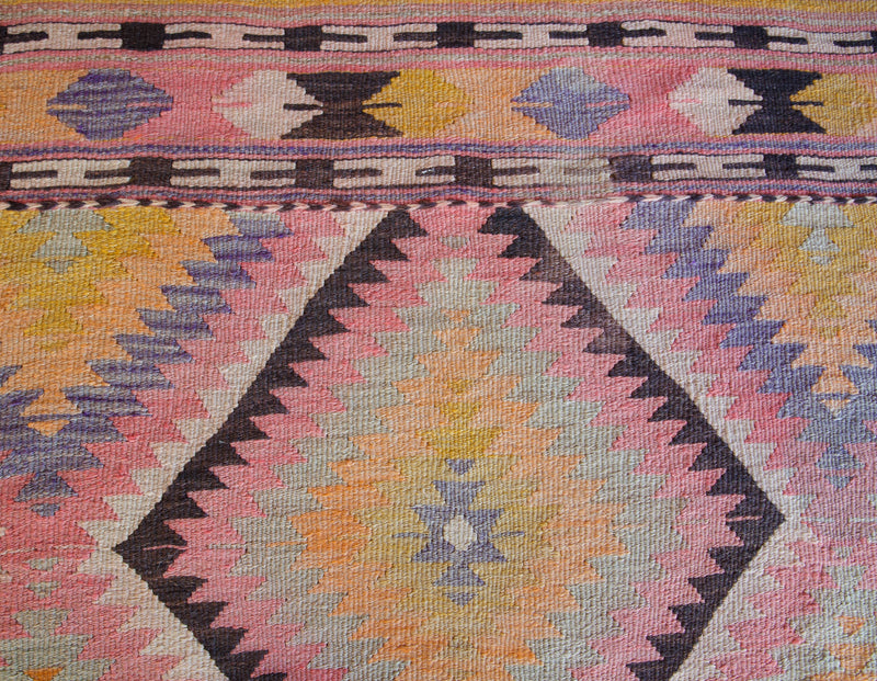 Vintage Turkish mini rug in room decor setting, old rug, antique rug, pastel colors, faded colors, Turkish rug, vintage rug, soft rug, Portland, Oregon, rug store, rug shop, local shop,  bright colors, bold colors