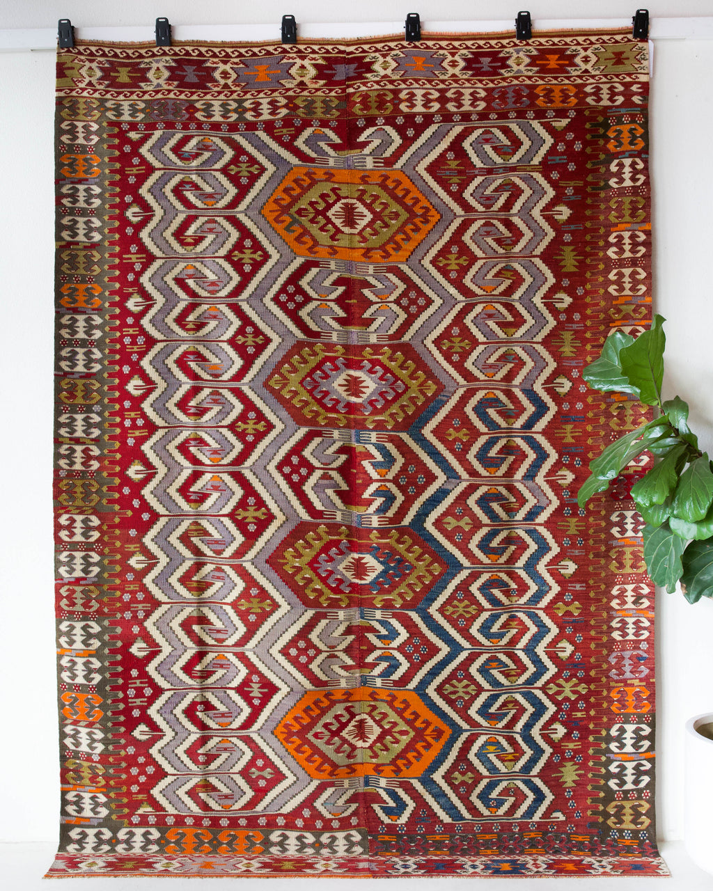 Vintage kilim rug in room decor setting, old rug, antique rug, pastel colors, faded colors, Turkish rug, vintage rug, soft rug, Portland, Oregon, rug store, rug shop, local shop, bold colors, bright colors, faded colors, antique kilim