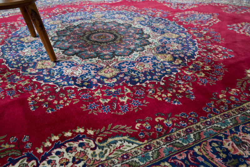 Vintage Turkish rug in a living room setting, pile rug, Turkish rug, vintage rug, portland, rug shop, bright colors, wild shaman, soft rug, bold color, Portland, Oregon, rug store, rug shop, local shop, antique rug,  carpet, ottoman design, floral carpet, traditional carpet, oriental rug