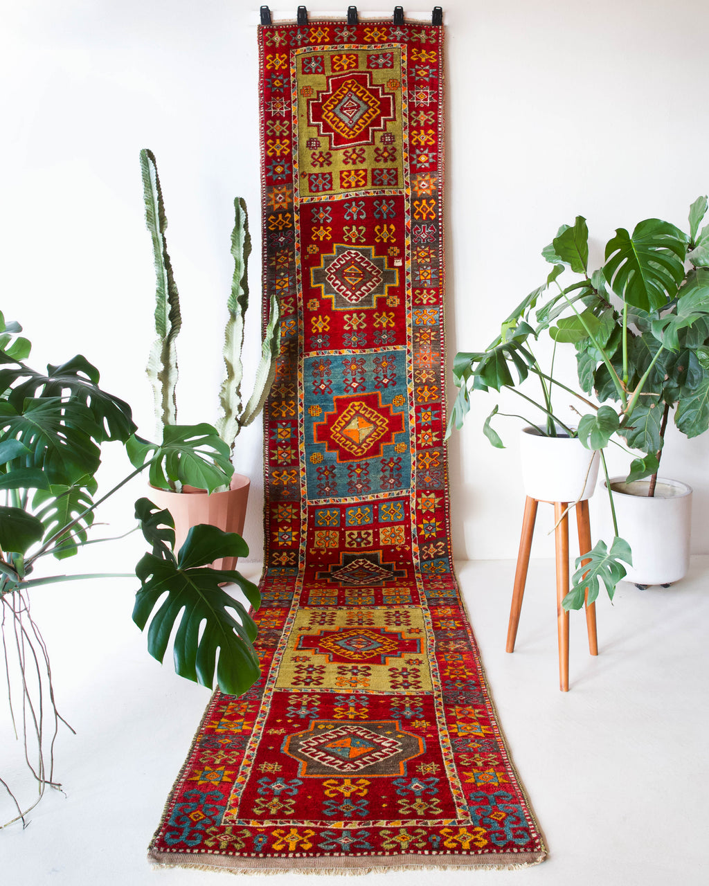 Vintage Turkish runner rug in a living room setting, pile rug, Turkish rug, vintage rug, portland, rug shop, bright colors, wild shaman, soft rug, bold color, Portland, Oregon, rug store, rug shop, local shop, antique rug