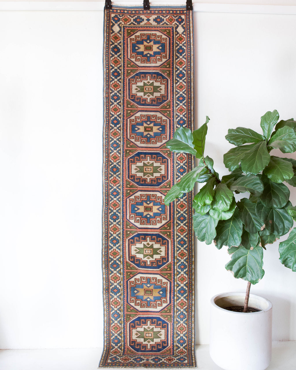 Vintage Turkish runner rug in living room setting, old rug, antique rug, pastel colors, faded colors, Turkish rug, vintage rug, soft rug, Portland, Oregon, rug store, rug shop, local shop