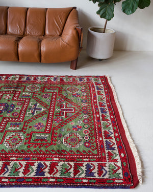 Vintage Turkish rug in a living room setting, pile rug, Turkish rug, vintage rug, portland, rug shop, bright colors, wild shaman, soft rug, bold color, Portland, Oregon, rug store, rug shop, local shop, antique rug, earthy colors