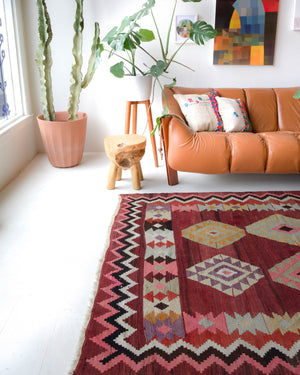 Vintage kilim rug in living room setting, bright colors, wild shaman, soft rug, bold color, Portland, Oregon, rug store, rug shop, local shop, vintage rug, modern kilim, warm
