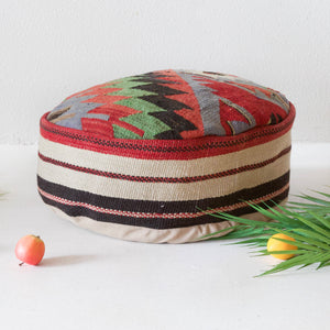 Floor pouf in a living room setting, pillow, turkish pillow, kilim pillow, home decor, decorative pillow, sham, rug pillow, decor, home decor, pouf, floor cushion, cushion, Portland, rugshop, Oregon, Wild Shaman, ottoman