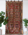 Vintage kilim rug in living room setting, old rug, antique rug, pastel colors, faded colors, Turkish rug, vintage rug, soft rug, Portland, Oregon, rug store, rug shop, local shop, earthy tones, earthy colors, warm colors