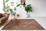 Vintage kilim rug in room decor setting, old rug, antique rug, pastel colors, faded colors, Turkish rug, vintage rug, soft rug, Portland, Oregon, rug store, rug shop, local shop, bold colors, bright colors, faded colors