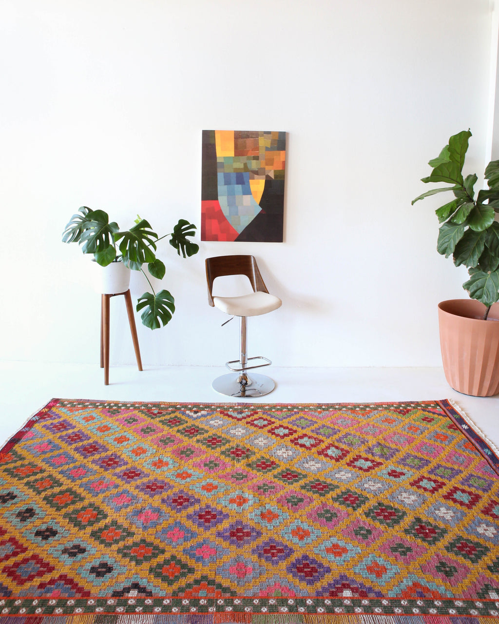 Vintage kilim rug in room decor setting, kilim, Turkish rug, vintage rug, portland, rug shop, bright colors, wild shaman, soft rug, bold color, Portland, Oregon, rug store, rug shop, local shop, antique rug