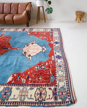 Vintage Turkish rug in a living room setting, pile rug, Turkish rug, vintage rug, portland, rug shop, bright colors, wild shaman, soft rug, bold color, Portland, Oregon, rug store, rug shop, local shop