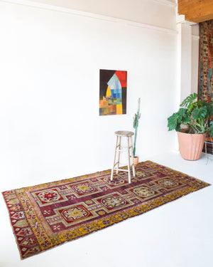 Vintage Turkish rug in a living room setting, pile rug, Turkish rug, vintage rug, portland, rug shop, bright colors, wild shaman, soft rug, bold color, Portland, Oregon, rug store, rug shop, local shop, antique rug, distressed rug, worn out rug