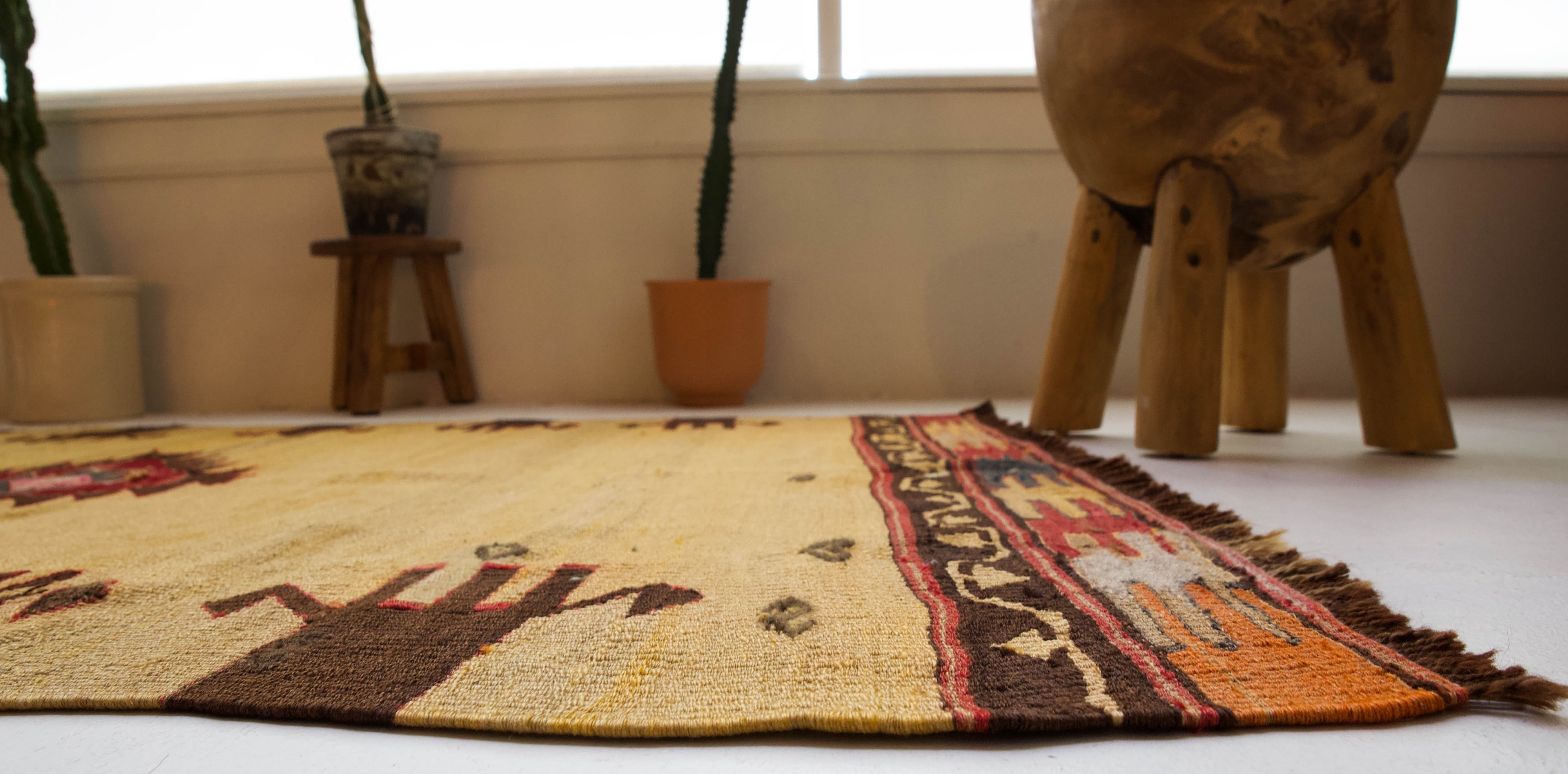 Vintage kilim rug in room decor setting, kilim, Turkish rug, vintage rug, portland, rug shop, bright colors, wild shaman, bold color, Portland, Oregon, rug store, rug shop, local shop, antique rug
