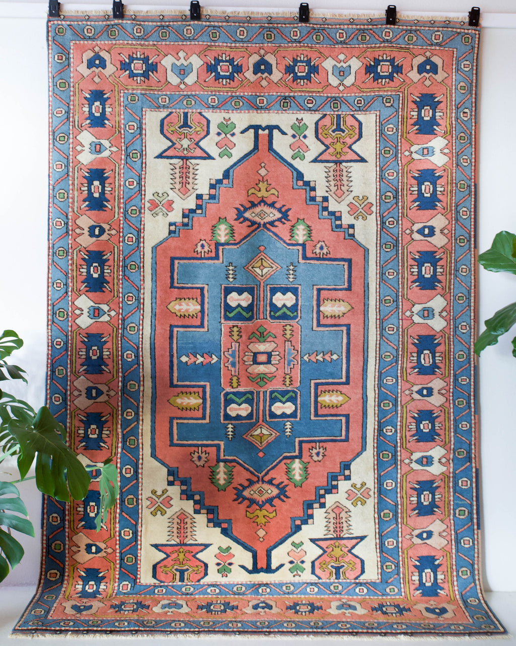 Vintage caucasian rug in a living room setting, pile rug, Turkish rug, vintage rug, portland, rug shop, bright colors, wild shaman, soft rug, bold color, Portland, Oregon, rug store, rug shop, local shop, soft rug, pastel colors, faded colors