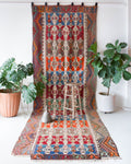 Antique kilim rug in living room setting, bright colors, wild shaman, soft rug, bold color, Portland, Oregon, rug store, rug shop, local shop, vintage rug, modern kilim, antique kilim, antique