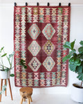 Vintage kilim rug in room decor setting, old rug, antique rug, pastel colors, faded colors, Turkish rug, vintage rug, soft rug, Portland, Oregon, rug store, rug shop, local shop, bold colors, bright colors