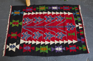 pile rug, Turkish rug, vintage rug, portland, rug shop, bright colors, wild shaman, area rug, red rug, mini rug, bold color, Portland, Oregon, rug store, rug shop, local shop, flat weave, kilim rug