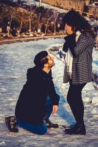 Man down on one knee proposing to his girlfriend by romance engineers Ireland's premium proposal planning service