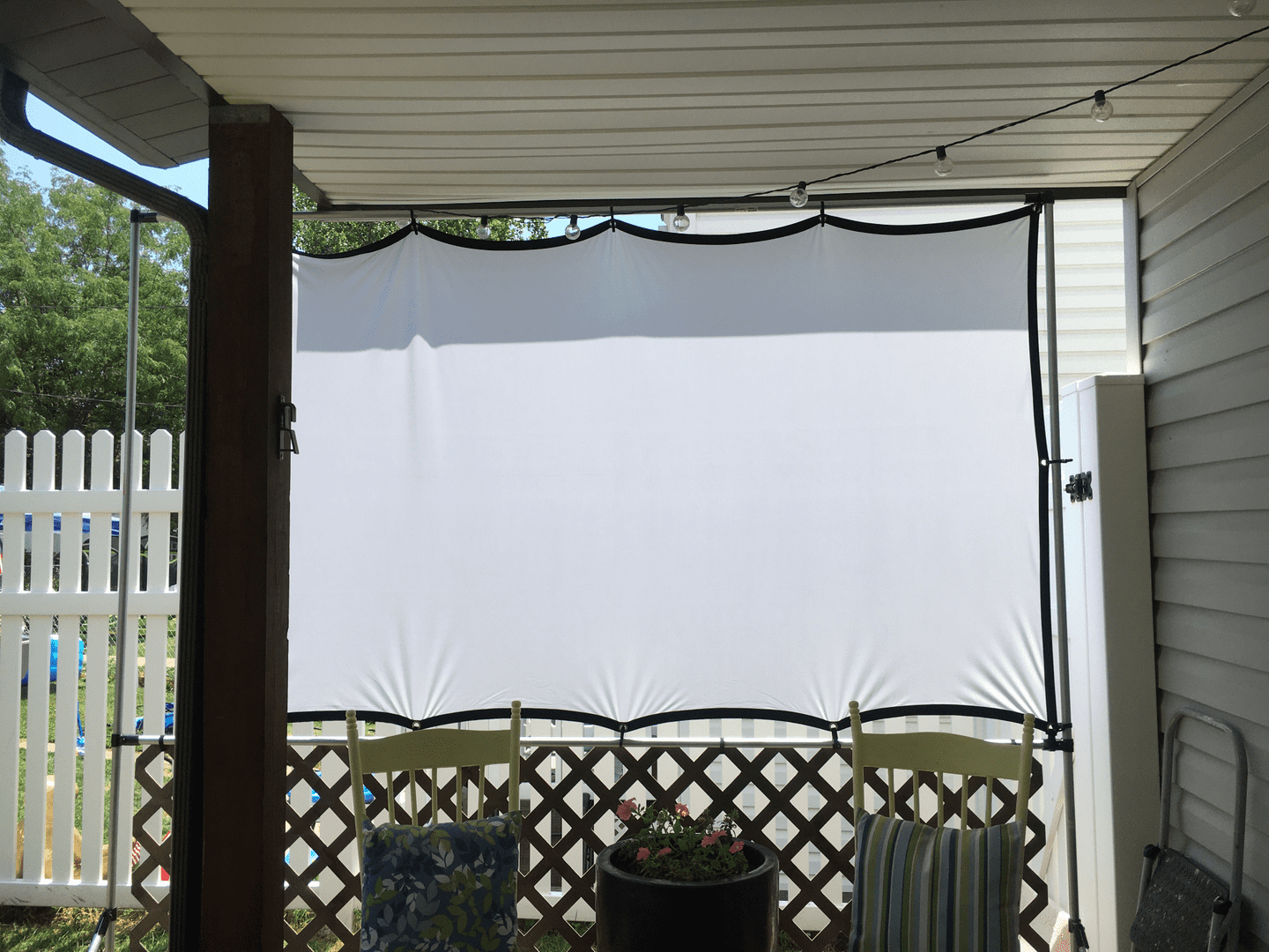 DIY projector screen frame mounted to a stand