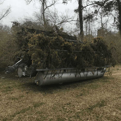Pontoon Boat With A DIY Duck Blind Covered In Camoflouge