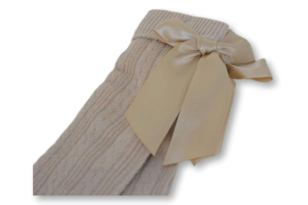 Knee high beige baby socks with silk ribbon