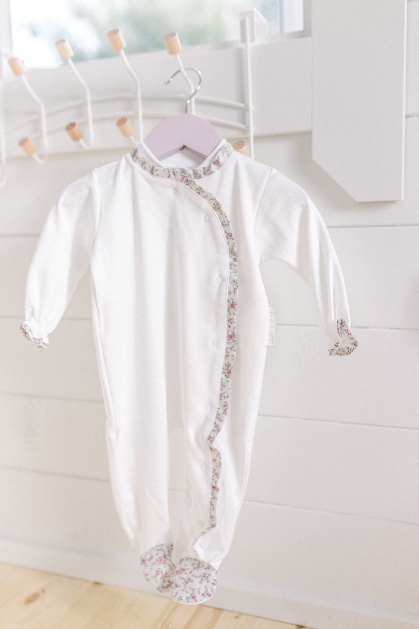 Floral trim baby grow