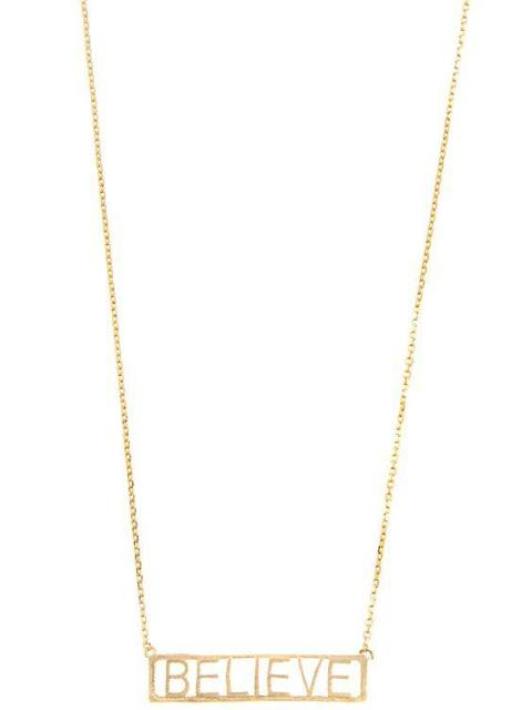 Gold outlined pendant necklace that says believe