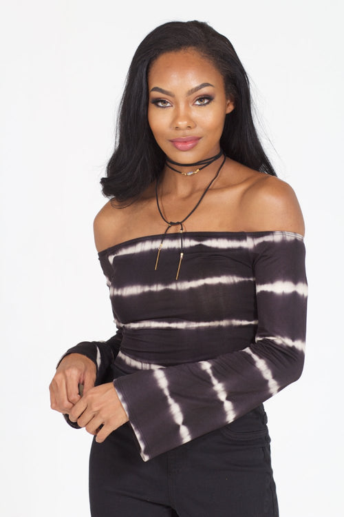 Black model in black and white bell sleeve, striped bodysuit with black jeans