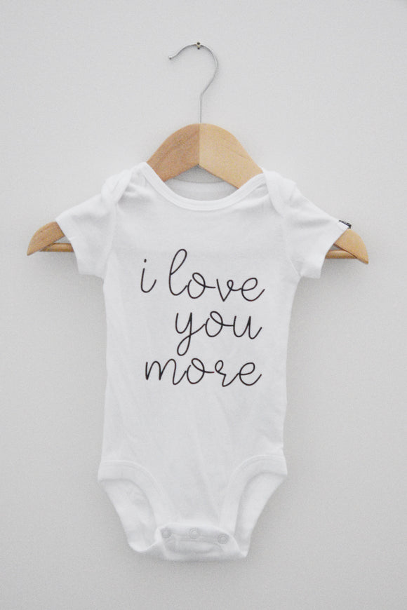 I love you more. [Onesie].