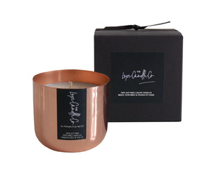 Rose scented candle in copper vessel