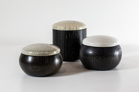 Ebonised walnut with Raku lidded containers, by Kate Schuricht, available at Padstow Gallery, Cornwall