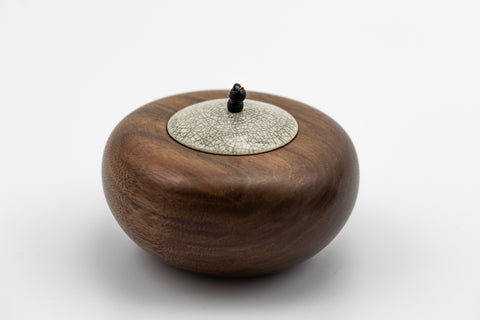 Walnut Pebble Pot and Raku Lid by Kate Schuricht, available at Padstow Gallery, Cornwall