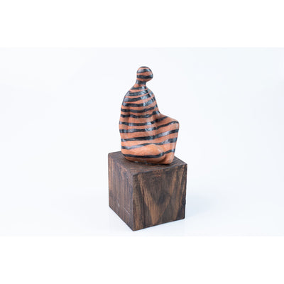 'Fem' seated figure on timber plinth, by Sophie Howard, available from Padstow Gallery, Cornwall