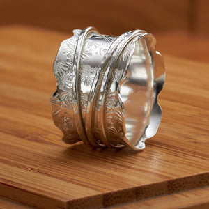Dandelion Spinner Ring by Jo Tinley, available at Padstow Gallery, Cornwall