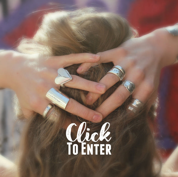 Woman with many upcycled silverware rings on her fingers