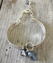 View from above a handmade Spoon link bracelet with smoky blue glass beads