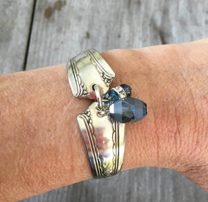Silveware handle link bracelet with smoky blue glass beads shown on model's arm