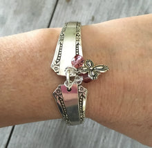 Del Mar Spoon Link Bracelet with pink beads an pewter cross charm shown on model's arm